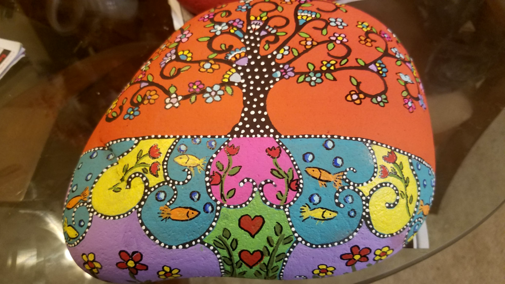 tree and fish painted rock
